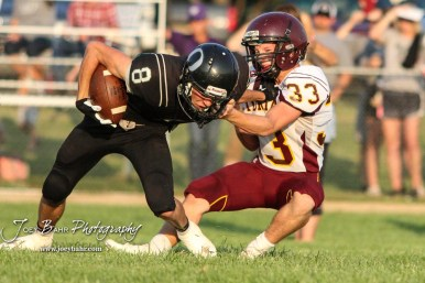 Victoria Knight #33 Tyler Knoles tries to pull Central Plains Oiler #8 Anthony Oberle down in the third quarter. The Victoria Knights defeated the Central Plains Oilers by a score of 34 to 8 at Central Plains High School in Claflin, Kansas on September 2, 2017. (Photo: Joey Bahr, www.joeybahr.com)