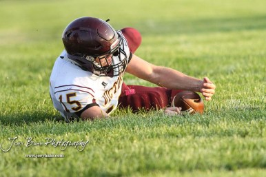 Victoria Knight #15 Lucas Taylor covers up a fumbled ball in the third quarter. The Victoria Knights defeated the Central Plains Oilers by a score of 34 to 8 at Central Plains High School in Claflin, Kansas on September 2, 2017. (Photo: Joey Bahr, www.joeybahr.com)