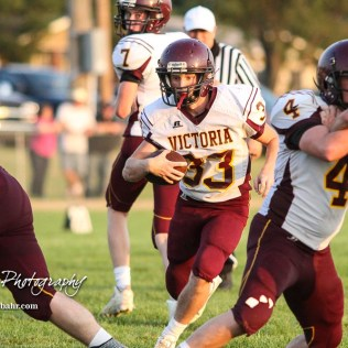 Victoria Knight #33 Tyler Knoles rushes through a hole in the line in the fourth quarter. The Victoria Knights defeated the Central Plains Oilers by a score of 34 to 8 at Central Plains High School in Claflin, Kansas on September 2, 2017. (Photo: Joey Bahr, www.joeybahr.com)