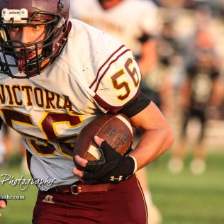 Victoria Knight #56 Cooper Pfanenstiel rushes with the ball in the fourth quarter. The Victoria Knights defeated the Central Plains Oilers by a score of 34 to 8 at Central Plains High School in Claflin, Kansas on September 2, 2017. (Photo: Joey Bahr, www.joeybahr.com)