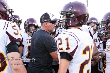 Victoria Knight Head Coach Doug Oberle addresses his players at the end of the game. The Victoria Knights defeated the Central Plains Oilers by a score of 34 to 8 at Central Plains High School in Claflin, Kansas on September 2, 2017. (Photo: Joey Bahr, www.joeybahr.com)