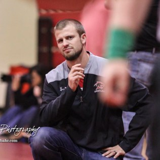Great Bend Head Coach Nathan Brockelman reacts to a ruling by an official during a match. The 2017 Cardinal Corner Classic Wrestling Tournament was held at Hoisington Activity Center in Hoisington, Kansas on December 15, 2017. (Photo: Joey Bahr, www.joeybahr.com)
