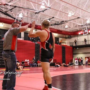 Sean Urban of Hoisington celebrates his pin fall win with a coach. The 2017 Cardinal Corner Classic Wrestling Tournament was held at Hoisington Activity Center in Hoisington, Kansas on December 15, 2017. (Photo: Joey Bahr, www.joeybahr.com)