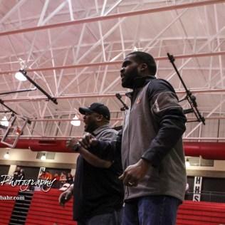 Larned coaches talk to their wrestler during a 126 pound weight class match. The 2017 Cardinal Corner Classic Wrestling Tournament was held at Hoisington Activity Center in Hoisington, Kansas on December 15, 2017. (Photo: Joey Bahr, www.joeybahr.com)