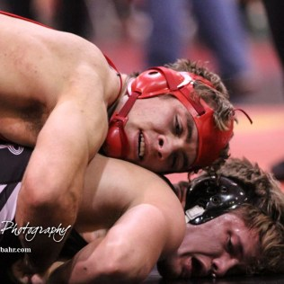 Gage Fritz of Great Bend tries to break the grip of Christopher Ball of Hoisington in their 152 pound weight class match. Ball won the match in a 7 to 1 decision. The 2017 Cardinal Corner Classic Wrestling Tournament was held at Hoisington Activity Center in Hoisington, Kansas on December 15, 2017. (Photo: Joey Bahr, www.joeybahr.com)