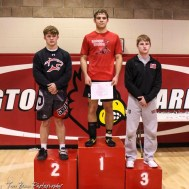 The 152 pound weight class finishers: First Place Christopher Ball of Hoisington, Second Place Gage Fritz of Great Bend, Third Place Derek Roever of Marysville. The 2017 Cardinal Corner Classic Wrestling Tournament was held at Hoisington Activity Center in Hoisington, Kansas on December 15, 2017. (Photo: Joey Bahr, www.joeybahr.com)
