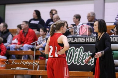 Hoisington Lady Cardinal #21 Suzanna Schneider talks to Head Coach Mandy Mason during a stop in the action. The Central Plains Lady Oilers defeated Hoisington Lady Cardinals by a score of 88 to 23 in a basketball game held at Central Plains High School in Claflin, Kansas on December 1, 2017. (Photo: Joey Bahr, www.joeybahr.com)