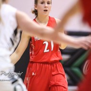 Hoisington Lady Cardinal #21 Suzanna Schneider looks for a teammate to pass the ball to. The Central Plains Lady Oilers defeated Hoisington Lady Cardinals by a score of 88 to 23 in a basketball game held at Central Plains High School in Claflin, Kansas on December 1, 2017. (Photo: Joey Bahr, www.joeybahr.com)