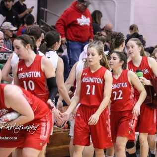 Members of the Central Plains Lady Oilers and Hoisington Lady Cardinals shake hands following the game. The Central Plains Lady Oilers defeated Hoisington Lady Cardinals by a score of 88 to 23 in a basketball game held at Central Plains High School in Claflin, Kansas on December 1, 2017. (Photo: Joey Bahr, www.joeybahr.com)