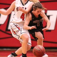 Buhler Lady Crusader #1 Haley Miller tries to drive past the defense of Great Bend Lady Panther #4 Alyssa Herter. The Great Bend Lady Panthers defeated the Buhler Lady Crusaders by a score of 52 to 38 the Great Bend High School Field House in Great Bend, Kansas on January 12, 2018. (Photo: Joey Bahr, www.joeybahr.com)