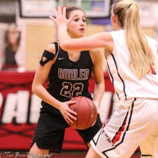 Buhler Lady Crusader #22 Maggie Epp looks for an open teammate to pass the ball to. The Great Bend Lady Panthers defeated the Buhler Lady Crusaders by a score of 52 to 38 the Great Bend High School Field House in Great Bend, Kansas on January 12, 2018. (Photo: Joey Bahr, www.joeybahr.com)