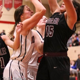 Great Bend Lady Panther #5 Camryn Dunekack goes up for a shot as Buhler Lady Crusader #15 Alyvia Owens tries to block the shot. The Great Bend Lady Panthers defeated the Buhler Lady Crusaders by a score of 52 to 38 the Great Bend High School Field House in Great Bend, Kansas on January 12, 2018. (Photo: Joey Bahr, www.joeybahr.com)