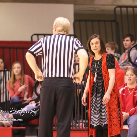 Hoisington Lady Cardinal Head Coach Mandy Mason discusses a foul call with an official. The Hoisington Lady Cardinals defeated the Ellinwood Lady Eagles by a score of 46 to 19 in the Consolation Semi-Final of the 2018 Hoisington Winter Jam at the Hoisington Activity Center in Hoisington, Kansas on January 18, 2018. (Photo: Joey Bahr, www.joeybahr.com)