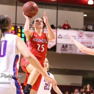 Hoisington Lady Cardinal #25 Maleigha Schmidt takes a jump shoot from the middle of the lane. The Hoisington Lady Cardinals defeated the Ellinwood Lady Eagles by a score of 46 to 19 in the Consolation Semi-Final of the 2018 Hoisington Winter Jam at the Hoisington Activity Center in Hoisington, Kansas on January 18, 2018. (Photo: Joey Bahr, www.joeybahr.com)