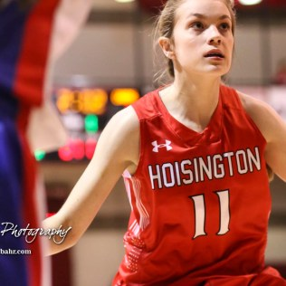 Hoisington Lady Cardinal #11 Keeley Wolf defends on an inbounds play. The Hoisington Lady Cardinals defeated the Ellinwood Lady Eagles by a score of 46 to 19 in the Consolation Semi-Final of the 2018 Hoisington Winter Jam at the Hoisington Activity Center in Hoisington, Kansas on January 18, 2018. (Photo: Joey Bahr, www.joeybahr.com)