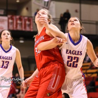 Hoisington Lady Cardinal #32 Kelsi Dalton and Ellinwood Lady Eagle #22 Kennedy Harrington tie up under the basket for a possible rebound. The Hoisington Lady Cardinals defeated the Ellinwood Lady Eagles by a score of 46 to 19 in the Consolation Semi-Final of the 2018 Hoisington Winter Jam at the Hoisington Activity Center in Hoisington, Kansas on January 18, 2018. (Photo: Joey Bahr, www.joeybahr.com)