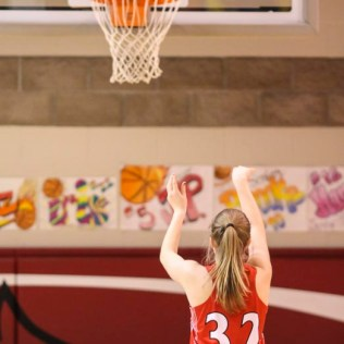 Hoisington Lady Cardinal #32 Kelsi Dalton shoots a free throw attempt. The Hoisington Lady Cardinals defeated the Ellinwood Lady Eagles by a score of 46 to 19 in the Consolation Semi-Final of the 2018 Hoisington Winter Jam at the Hoisington Activity Center in Hoisington, Kansas on January 18, 2018. (Photo: Joey Bahr, www.joeybahr.com)