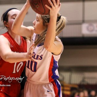 Ellinwood Lady Eagle #10 Ashtn Klepper looks for a teammate to pass the ball to as Hoisington Lady Cardinal #10 Brooke Reif defends closely. The Hoisington Lady Cardinals defeated the Ellinwood Lady Eagles by a score of 46 to 19 in the Consolation Semi-Final of the 2018 Hoisington Winter Jam at the Hoisington Activity Center in Hoisington, Kansas on January 18, 2018. (Photo: Joey Bahr, www.joeybahr.com)
