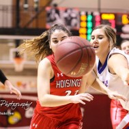 Hoisington Lady Cardinal #22 Iris Suarez goes for the loose ball as Ellinwood Lady Eagle #30 Rebecca Henderson tries to keep her away. The Hoisington Lady Cardinals defeated the Ellinwood Lady Eagles by a score of 46 to 19 in the Consolation Semi-Final of the 2018 Hoisington Winter Jam at the Hoisington Activity Center in Hoisington, Kansas on January 18, 2018. (Photo: Joey Bahr, www.joeybahr.com)