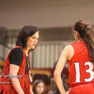 Hoisington Lady Cardinal Head Coach Mandy Mason discusses a play with #13 Isabelle Gonzalez. The Hoisington Lady Cardinals defeated the Ellinwood Lady Eagles by a score of 46 to 19 in the Consolation Semi-Final of the 2018 Hoisington Winter Jam at the Hoisington Activity Center in Hoisington, Kansas on January 18, 2018. (Photo: Joey Bahr, www.joeybahr.com)