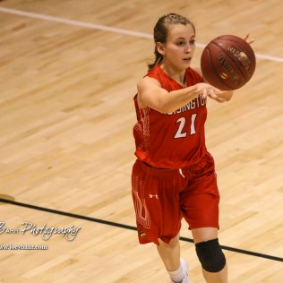 Hoisington Lady Cardinal #21 Suzanna Schneider passes the ball to a teammate. The Hoisington Lady Cardinals defeated the Ellinwood Lady Eagles by a score of 46 to 19 in the Consolation Semi-Final of the 2018 Hoisington Winter Jam at the Hoisington Activity Center in Hoisington, Kansas on January 18, 2018. (Photo: Joey Bahr, www.joeybahr.com)