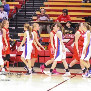 Members of the Hoisington Lady Cardinals and Ellinwood Lady Eagles shake hands following the conclusion of the game. The Hoisington Lady Cardinals defeated the Ellinwood Lady Eagles by a score of 46 to 19 in the Consolation Semi-Final of the 2018 Hoisington Winter Jam at the Hoisington Activity Center in Hoisington, Kansas on January 18, 2018. (Photo: Joey Bahr, www.joeybahr.com)