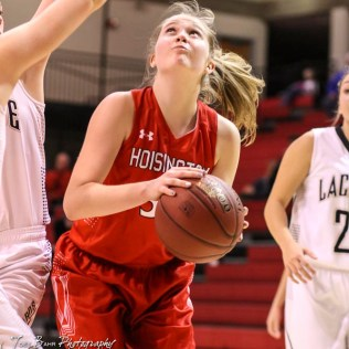 Hoisington Lady Cardinal #32 Kelsi Dalton prepares to take a shot. The LaCrosse Lady Leopards defeated the Hoisington Lady Cardinals by a score of 32 to 27 in the First Round of the 2018 Hoisington Winter Jam at the Hoisington Activity Center in Hoisington, Kansas on January 16, 2018. (Photo: Joey Bahr, www.joeybahr.com)