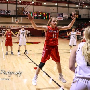 Hoisington Lady Cardinal #11 Keeley Wolf jumps to try and get in the way of an inbound pass. The LaCrosse Lady Leopards defeated the Hoisington Lady Cardinals by a score of 32 to 27 in the First Round of the 2018 Hoisington Winter Jam at the Hoisington Activity Center in Hoisington, Kansas on January 16, 2018. (Photo: Joey Bahr, www.joeybahr.com)