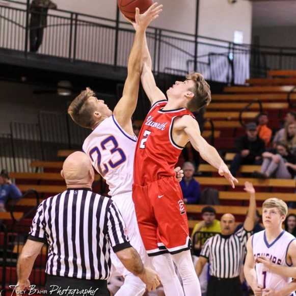 Otis-Bison Cougar #23 Maitland Wiltse and Ellsworth Bearcat #3 Jordan Base jump for the opening tip off. The Ellsworth Bearcats defeated the Otis-Bison Cougars by a score of 58 to 37 in the Third Place game of the 2018 Hoisington Winter Jam at the Hoisington Activity Center in Hoisington, Kansas on January 20, 2018. (Photo: Joey Bahr, www.joeybahr.com)