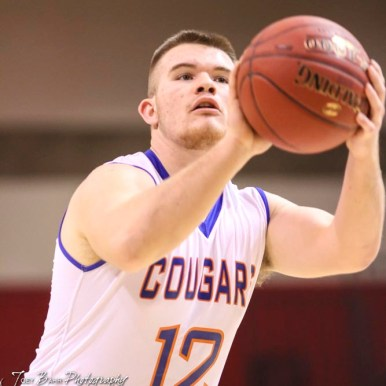 Otis-Bison Cougar #12 Luke Higgason shoots a free throw attempt. The Ellsworth Bearcats defeated the Otis-Bison Cougars by a score of 58 to 37 in the Third Place game of the 2018 Hoisington Winter Jam at the Hoisington Activity Center in Hoisington, Kansas on January 20, 2018. (Photo: Joey Bahr, www.joeybahr.com)