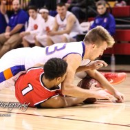 Otis-Bison Cougar #23 Maitland Wiltse dives for a loose ball as Ellsworth Bearcat #1 Kash Travnicheck tries to corral it. The Ellsworth Bearcats defeated the Otis-Bison Cougars by a score of 58 to 37 in the Third Place game of the 2018 Hoisington Winter Jam at the Hoisington Activity Center in Hoisington, Kansas on January 20, 2018. (Photo: Joey Bahr, www.joeybahr.com)