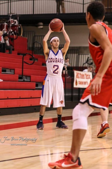 Otis-Bison Cougar #2 Caleb Cheely holds the ball up as he looks for a teammate to pass the ball to. The Ellsworth Bearcats defeated the Otis-Bison Cougars by a score of 58 to 37 in the Third Place game of the 2018 Hoisington Winter Jam at the Hoisington Activity Center in Hoisington, Kansas on January 20, 2018. (Photo: Joey Bahr, www.joeybahr.com)