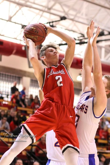 Ellsworth Bearcat #2 Remington Cravens goes for a layup as Otis-Bison Cougar #13 Clade Anderson defends. The Ellsworth Bearcats defeated the Otis-Bison Cougars by a score of 58 to 37 in the Third Place game of the 2018 Hoisington Winter Jam at the Hoisington Activity Center in Hoisington, Kansas on January 20, 2018. (Photo: Joey Bahr, www.joeybahr.com)
