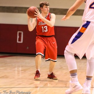 Ellsworth Bearcat #13 Drew Kratzer looks for a teammate to pass the ball to. The Ellsworth Bearcats defeated the Otis-Bison Cougars by a score of 58 to 37 in the Third Place game of the 2018 Hoisington Winter Jam at the Hoisington Activity Center in Hoisington, Kansas on January 20, 2018. (Photo: Joey Bahr, www.joeybahr.com)