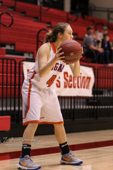 Otis-Bison Lady Cougar #4 Sidney Schneider looks for a teammate to pass the ball to. The Russell Lady Broncos defeated the Otis-Bison Lady Cougars by a score of 54 to 34 in the Girls Championship game of the 2018 Hoisington Winter Jam at the Hoisington Activity Center in Hoisington, Kansas on January 20, 2018. (Photo: Joey Bahr, www.joeybahr.com)