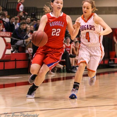Russell Lady Bronco #22 Samantha Leiker dribbles the ball down the court as Otis-Bison Lady Cougar #4 Sidney Schneider defends. The Russell Lady Broncos defeated the Otis-Bison Lady Cougars by a score of 54 to 34 in the Girls Championship game of the 2018 Hoisington Winter Jam at the Hoisington Activity Center in Hoisington, Kansas on January 20, 2018. (Photo: Joey Bahr, www.joeybahr.com)