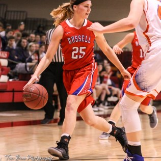 Russell Lady Bronco #25 Jaclyn Schulte dribbles the ball while looking for a teammate to pass the ball to. The Russell Lady Broncos defeated the Otis-Bison Lady Cougars by a score of 54 to 34 in the Girls Championship game of the 2018 Hoisington Winter Jam at the Hoisington Activity Center in Hoisington, Kansas on January 20, 2018. (Photo: Joey Bahr, www.joeybahr.com)