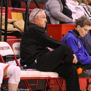 Otis-Bison Lady Cougar Head Coach Stan Ewy watches a play develop from the sidelines. The Russell Lady Broncos defeated the Otis-Bison Lady Cougars by a score of 54 to 34 in the Girls Championship game of the 2018 Hoisington Winter Jam at the Hoisington Activity Center in Hoisington, Kansas on January 20, 2018. (Photo: Joey Bahr, www.joeybahr.com)