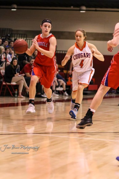 Russell Lady Bronco #3 Tiffany Dortland drives down the court as Otis-Bison Lady Cougar #4 Sidney Schneider gives chase. The Russell Lady Broncos defeated the Otis-Bison Lady Cougars by a score of 54 to 34 in the Girls Championship game of the 2018 Hoisington Winter Jam at the Hoisington Activity Center in Hoisington, Kansas on January 20, 2018. (Photo: Joey Bahr, www.joeybahr.com)