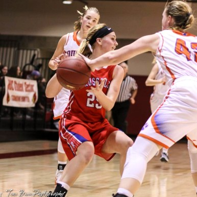 Russell Lady Bronco #25 Jaclyn Schulte tries to pass the ball as Otis-Bison Lady Cougar #42 Cora Anderson puts a hand on it. The Russell Lady Broncos defeated the Otis-Bison Lady Cougars by a score of 54 to 34 in the Girls Championship game of the 2018 Hoisington Winter Jam at the Hoisington Activity Center in Hoisington, Kansas on January 20, 2018. (Photo: Joey Bahr, www.joeybahr.com)