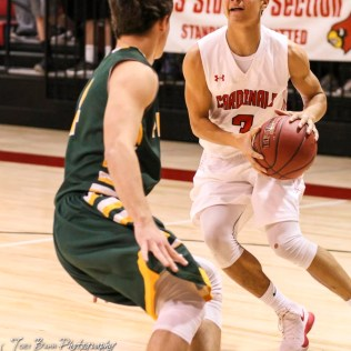 Hoisington Cardinal #3 Xavier Robinson looks to the basket as Pratt Greenback #4 Landen Studer defends. The Hoisington Cardinals defeated the Pratt Greenbacks by a score of 47 to 41 in the Boys Championship game of the 2018 Hoisington Winter Jam at the Hoisington Activity Center in Hoisington, Kansas on January 20, 2018. (Photo: Joey Bahr, www.joeybahr.com)