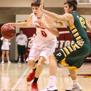 Hoisington Cardinal #0 Drew Nicholson tries to dribble past Pratt Greenback #12 Brett Winsor. The Hoisington Cardinals defeated the Pratt Greenbacks by a score of 47 to 41 in the Boys Championship game of the 2018 Hoisington Winter Jam at the Hoisington Activity Center in Hoisington, Kansas on January 20, 2018. (Photo: Joey Bahr, www.joeybahr.com)