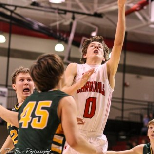 Hoisington Cardinal #0 Drew Nicholson goes for a layup over Pratt Greenback #45 Grant Bolen. The Hoisington Cardinals defeated the Pratt Greenbacks by a score of 47 to 41 in the Boys Championship game of the 2018 Hoisington Winter Jam at the Hoisington Activity Center in Hoisington, Kansas on January 20, 2018. (Photo: Joey Bahr, www.joeybahr.com)