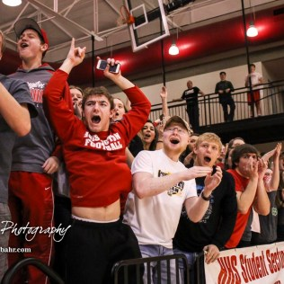 The Hoisington student section celebrates as victory looks certain in the game. The Hoisington Cardinals defeated the Pratt Greenbacks by a score of 47 to 41 in the Boys Championship game of the 2018 Hoisington Winter Jam at the Hoisington Activity Center in Hoisington, Kansas on January 20, 2018. (Photo: Joey Bahr, www.joeybahr.com)