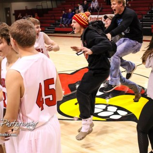 Members of the Hoisington student section rush onto the court to greet their team. The Hoisington Cardinals defeated the Pratt Greenbacks by a score of 47 to 41 in the Boys Championship game of the 2018 Hoisington Winter Jam at the Hoisington Activity Center in Hoisington, Kansas on January 20, 2018. (Photo: Joey Bahr, www.joeybahr.com)