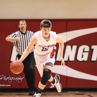 Ellinwood Eagle #15 Tyler Knop drives up the court with the ball. The Russell Broncos defeated the Ellinwood Eagles by a score of 60 to 17 in the Consolation Semi-Final of the 2018 Hoisington Winter Jam at the Hoisington Activity Center in Hoisington, Kansas on January 18, 2018. (Photo: Joey Bahr, www.joeybahr.com)