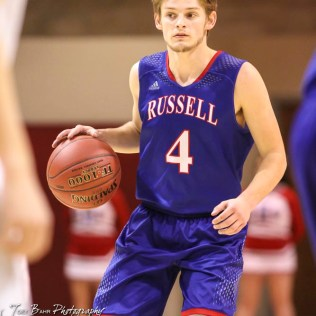 Russell Bronco #4 Austin Price dribbles the ball while waiting for a teammate to get open. The Russell Broncos defeated the Ellinwood Eagles by a score of 60 to 17 in the Consolation Semi-Final of the 2018 Hoisington Winter Jam at the Hoisington Activity Center in Hoisington, Kansas on January 18, 2018. (Photo: Joey Bahr, www.joeybahr.com)