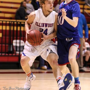 Ellinwood Eagle #24 Blake Garmam tries to drive to the lan as Russell Bronco #10 Koby Decker defends. The Russell Broncos defeated the Ellinwood Eagles by a score of 60 to 17 in the Consolation Semi-Final of the 2018 Hoisington Winter Jam at the Hoisington Activity Center in Hoisington, Kansas