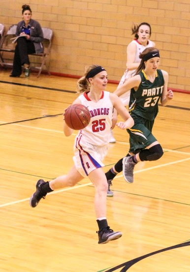 Russell Lady Bronco #25 Jaclyn Schulte drives with the ball. The Russell Lady Broncos faced the Pratt Lady Greenbacks in the First Round of the 2018 Hoisington Winter Jam at the Hoisington High School in Hoisington, Kansas on January 16, 2018. (Photo: Joey Bahr, www.joeybahr.com)