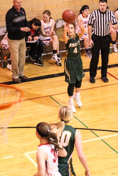 Pratt Lady Greenback #4 Allisan McGowan launches a three point shot. The Russell Lady Broncos faced the Pratt Lady Greenbacks in the First Round of the 2018 Hoisington Winter Jam at the Hoisington High School in Hoisington, Kansas on January 16, 2018. (Photo: Joey Bahr, www.joeybahr.com)